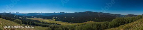 Panorama of the Colorado mountains in the morning with clear skies #377623397