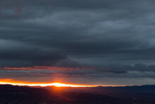 Sunset Over Mountains And Vall...