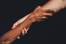 Black Lives Matter. Racial Friendship. Multicolor Male Hands Holding Together Isolated On Dark Copy Space. Ethnic Tolerance. No Racism. Peace Support