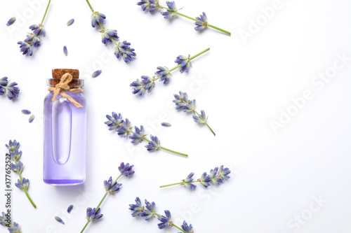 Composition with lavender flowers and natural essential oil on white background, Wallpaper Mural