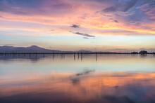 Wide View Of A Pink Sunset At Stagno Santa Gilla Near Cagliari, Sardinia