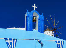 Greek Orthodox Church And Windmill In Santorini