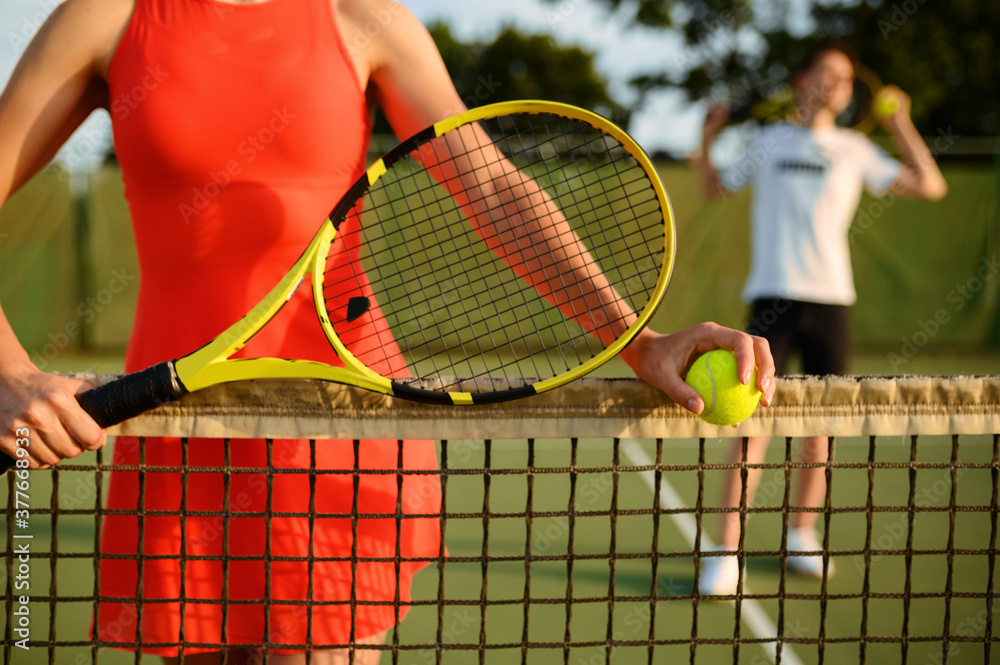 Fototapeta Male and female tennis players with rackets