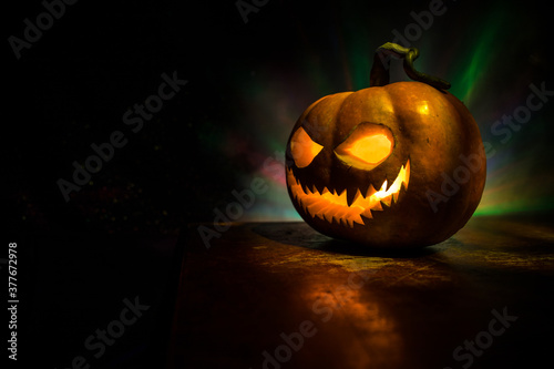 Fototapeta Halloween pumpkin smile and scary eyes for party night