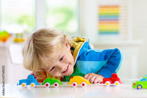 Fototapeta Boy playing toy cars. Kid with toys. Child and car obraz