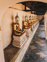 Row Of Golden Peaceful Sitting Buddha Statue In The Thailand Temple