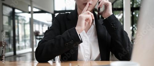 Closeup businesswoman talking Secrets on the phone. Wallpaper Mural