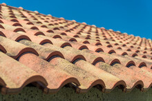 Closeup Of Red Tiles Covering The Roof Part Of House