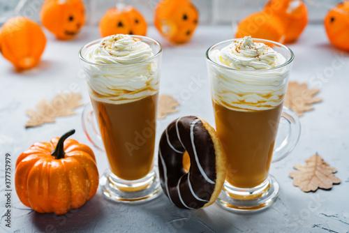 Fototapeta Pumpkin spice latte with whipped cream and cinnamon obraz