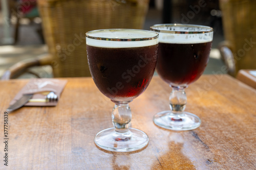 Glasses with cold dark strong Belgian beer served outdoor Fototapeta