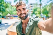 Young Hispanic Man Smiling Hap...