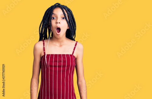 Cute african american girl wearing casual clothes scared and amazed with open mo Canvas Print