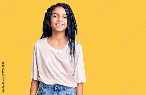 Fotografija Cute african american girl wearing casual clothes looking positive and happy sta