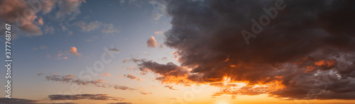 Summer sunset sky high resolution panorama with fleece colorful clouds. Evening dusk good weather natural background.