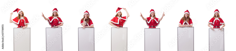 Fototapeta Young woman in red santa costume with blank board