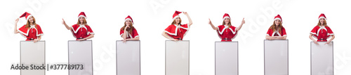 Obraz Young woman in red santa costume with blank board - fototapety do salonu