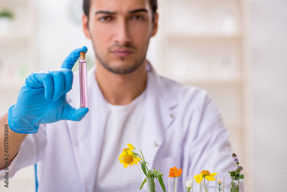 Fototapeta Young male chemist in perfume synthesis concept