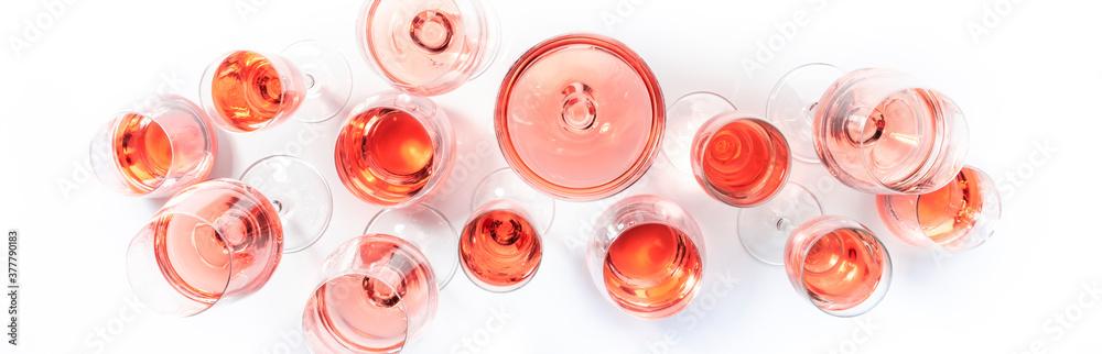 Fototapeta Rose wine glasses on wine tasting. Degustation different varieties of pink wine concept. White background, top view, hard light