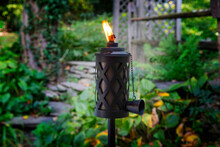 Lit Tiki Torch At Picnic