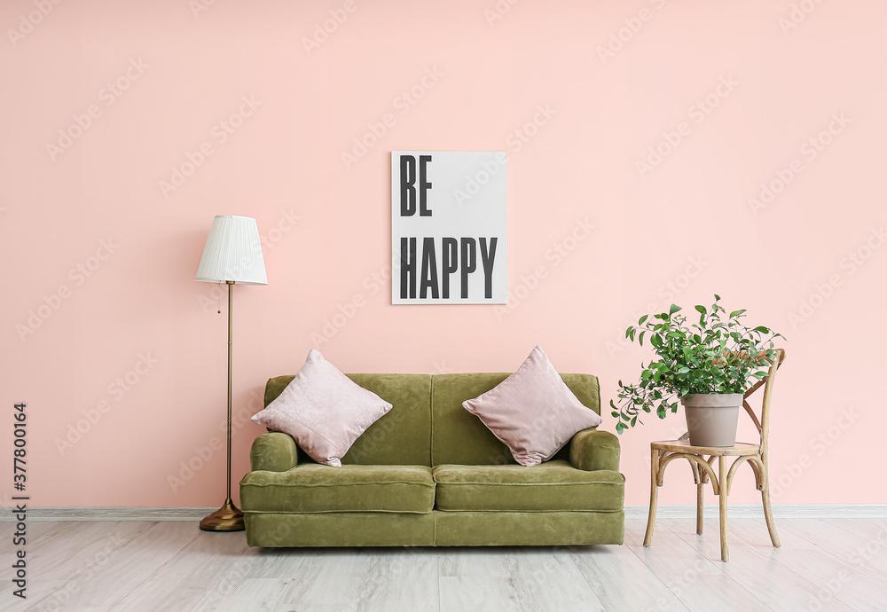 Fototapeta Stylish soft sofa near color wall in room