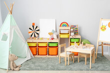 Interior Of Modern Children's Room With Play Tent And Toys