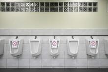 Row Of Urinals Men Public Toil...