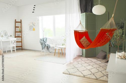 Fototapeta Interior of living room with stylish hammock obraz