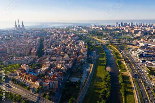 Photo Top view on Barcelona and district Sant Adria de Besos, Besos river