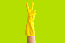 Hand In Rubber Glove Showing V...