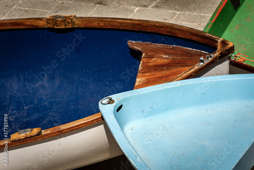 Fotomural Small Rowing Boats on the Quay of the Harbor - Liguria Italy