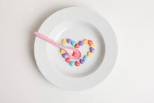 Heart Shaped Colorful Candies On Plate With Spoon