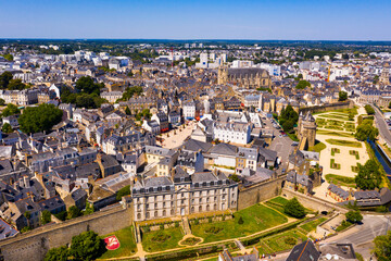 Drone view of Vannes overlooking fortified city walls and lawns with floral design, Brittany, France