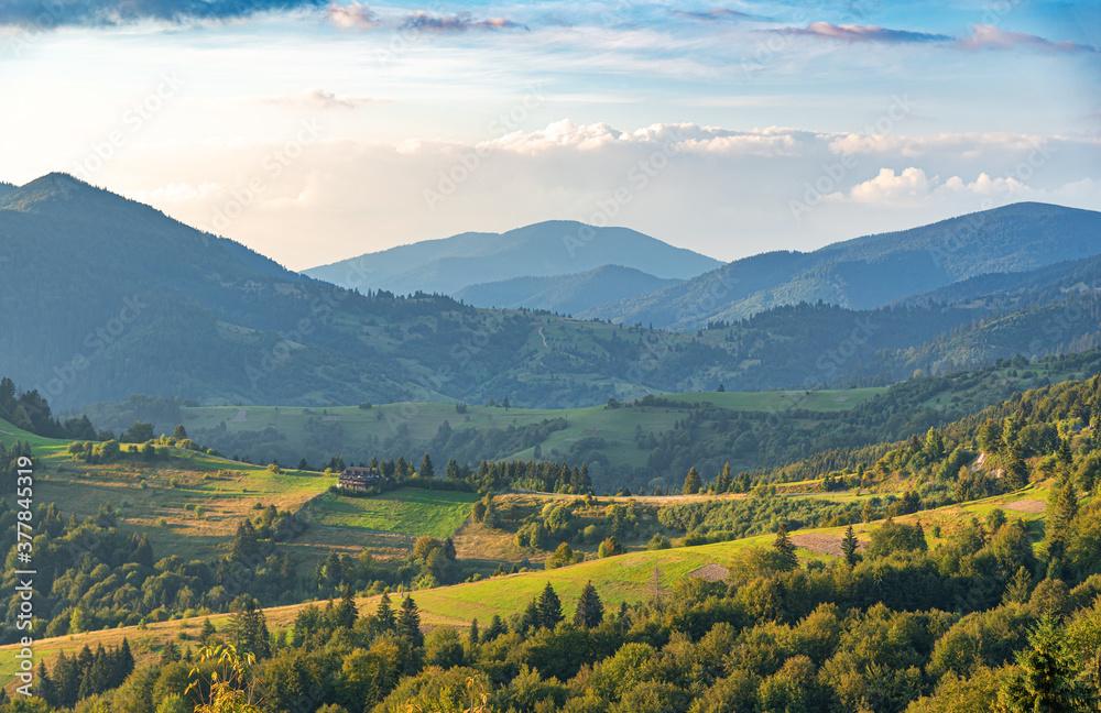 Fototapeta Beautiful sunset on the background of the mountain landscape. Carpathians.