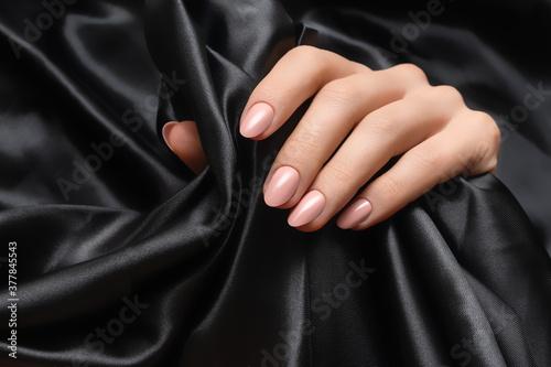Female hand with pink nail design Fototapeta