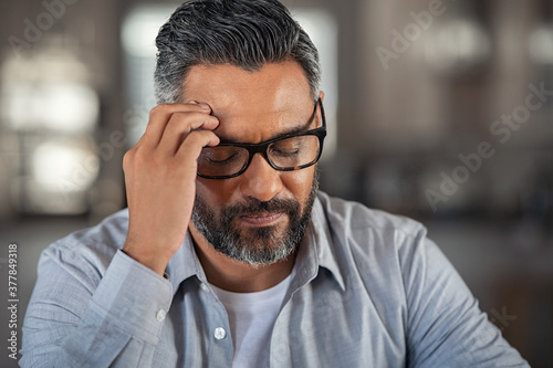 Stressed ethnic man with headache Wallpaper Mural
