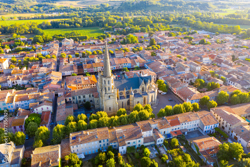 Fotografie, Obraz Scenic aerial view of Mirepoix town and surroundings in Hers valley in summer overlooking Gothic building of Roman Catholic Cathedral, France