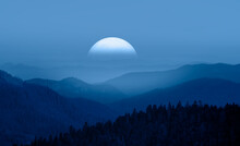 Beautiful Landscape With Blue Misty Silhouettes Of Mountains Against Super Blue Moon Rising