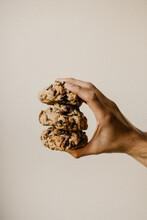 Hand Holding Three Cookies