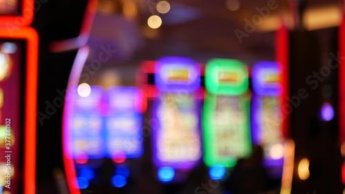 Photo Defocused slot machines glow in casino on fabulous Las Vegas Strip, USA
