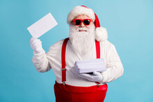 Portrait Of His He Nice Attractive Cheerful Confident White-haired Santa Father Holding In Hand Pile Mail Letters Wish List December Eve Noel Isolated Bright Vivid Shine Vibrant Blue Color Background