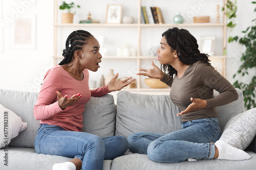 Mad african girls screaming at each other at home Canvas Print