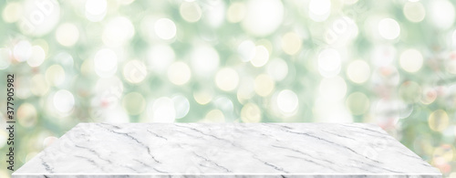 Fototapeta Perspective marble table with blur Christmas tree decorate string light .Panoramic banner mockup for product display greeting card obraz