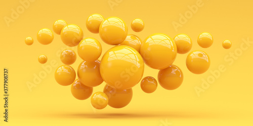 Many spheres falling on a yellow background. 3d render.