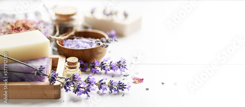 Fototapeta Lavender's soap bars and Spa products with lavender flowers on a white table. obraz