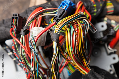 A cable of matted wires of different colors with connectors in the electrical wiring of the car Canvas