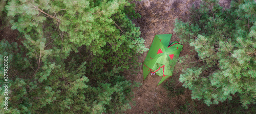 Aerial tent in the forest Fotobehang