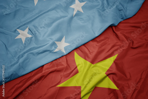 Cuadros en Lienzo waving colorful flag of vietnam and national flag of Federated States of Micronesia