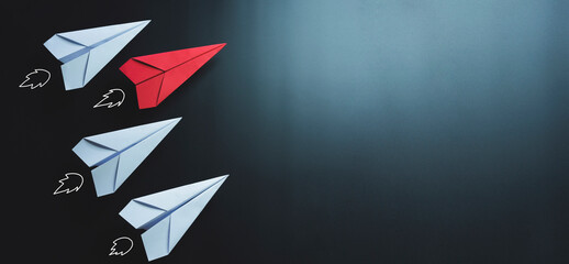 Leadership, red paper plane on black background, copy space