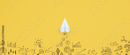 Business success, innovation and solution concept, Paper plane and business strategy on yellow background