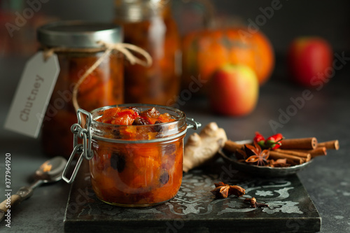 Canvastavla Homemade pumpkin and apple chutney with raisins in jars on a table